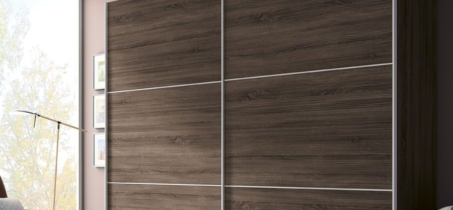 El Armarios correderos JORCNX138 en madera laminada, con guías exteriores